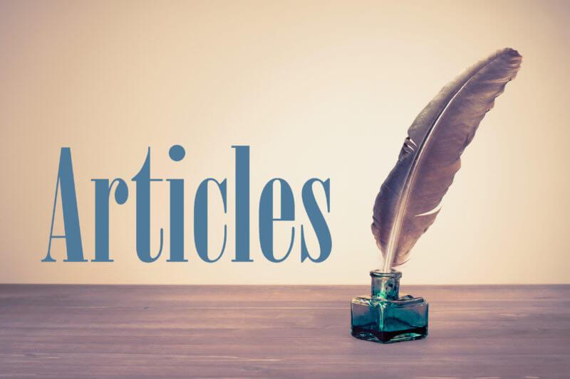 gambar ilustrasi bertuliskan articles, terdapat botol tinta kecil beserta sehelai bulu untuk menulis